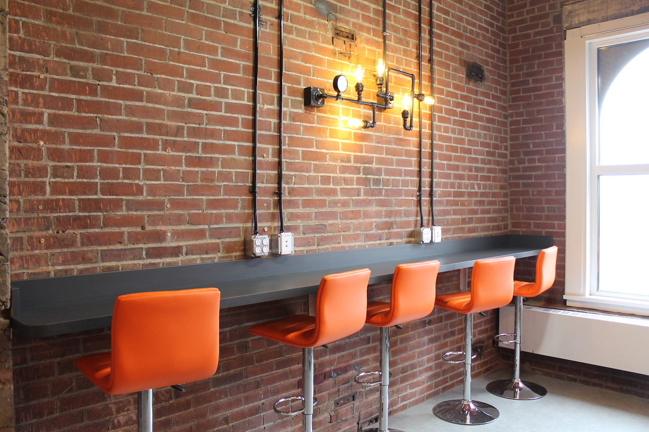 Brick walls and orange chairs